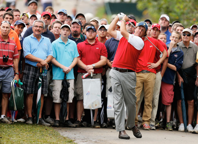 Phil Mickelson (pictured) and Keegan Bradley halved their match against Jason Day and Graham DeLaet Sunday morning.