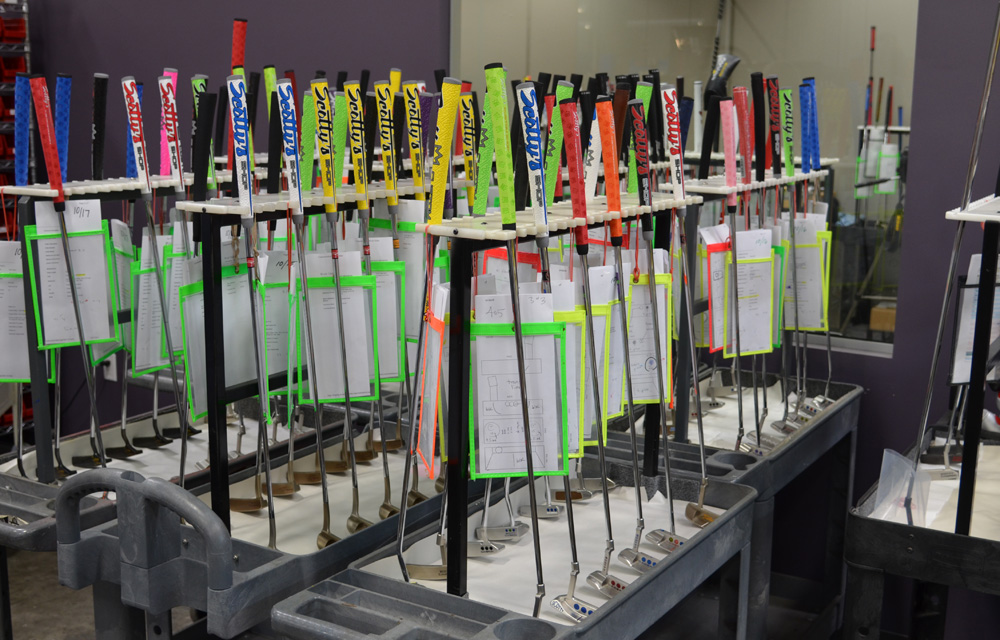 Anyone can have a Scotty Cameron putter customized at Scotty's Custom Shop. Once it arrives, every putter is carefully labeled and put on a rack before it's rolled to the proper workstation.
