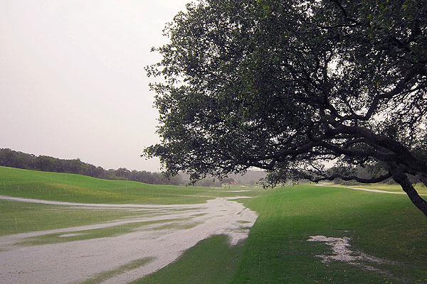 Saturday at the Valero Texas Open                       Before the leaders could start their third round, rain pounds La Cantera and play was suspended for about five hours.