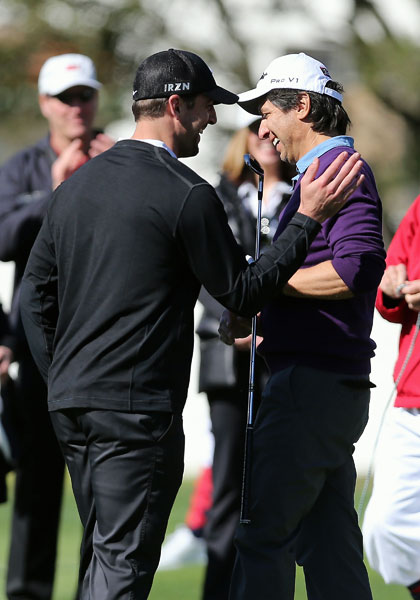 Ray Romano accepts congratulations from Green Bay Packers quarterback Aaron Rodgers in the first round.