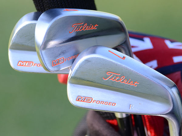 Rickie Fowler is playing the new Titleist 712 MB irons, but like his old clubs, they're trimmed in Oklahoma State orange.