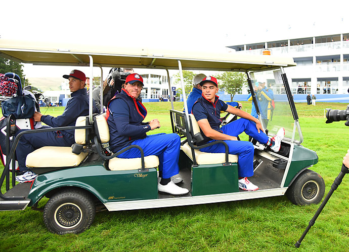Rickie Fowler, Phil Mickelson and other U.S. team members got a lift around the course.