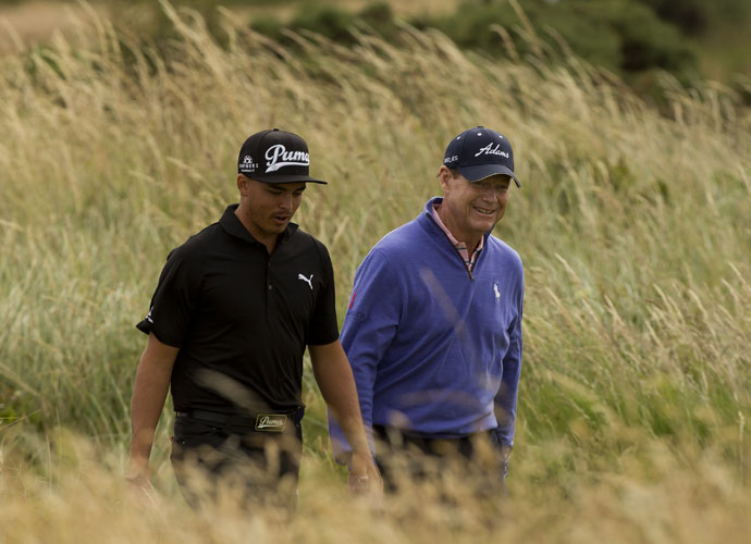 Tom Watson and Rickie Fowler walk the sixth fairway during their practice round. Watson will captain the American Ryder Cup team in September. Fowler is currently seventh in the Ryder Cup standings.