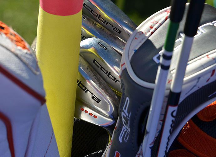 Tucked behind alignment sticks and a neon-colored stretching pole are Rickie Fowler's Cobra AMP Cell Pro irons.