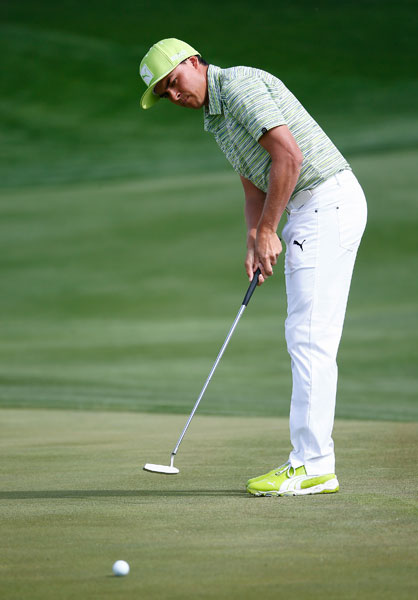RIckie Fowler putts during his 1-up victory over Sergio Garcia.