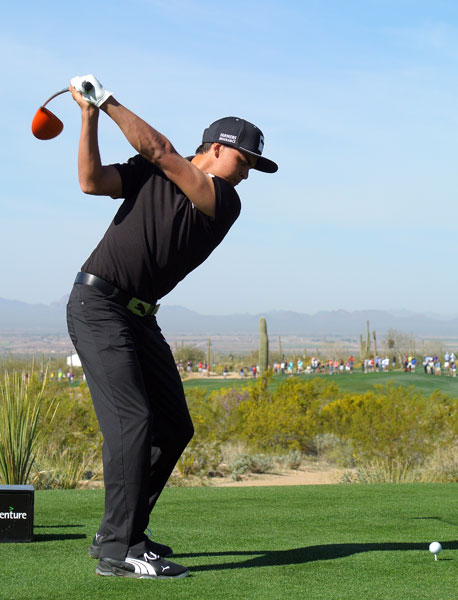 Rickie Fowler loads up to drive the ball on the second tee.