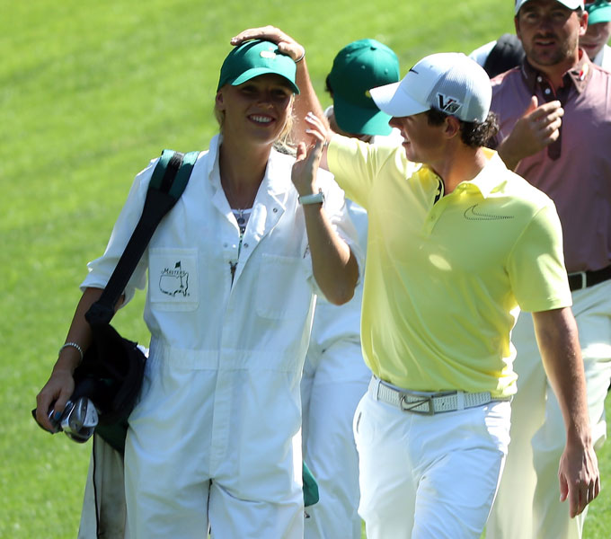 Rory McIlroy had his girlfriend-turned-caddie, Caroline Wozniacki, on the bag Wednesday. The former world No. 1 women's tennis player took a turn at golf on No. 9, but she dribbled the ball straight into the water.