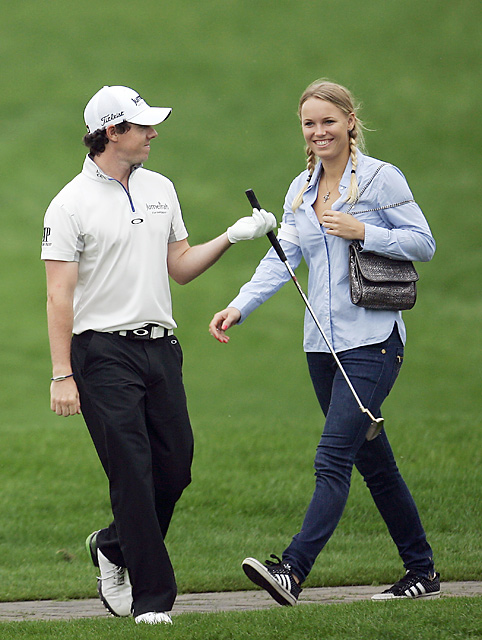 Caroline Wozniacki passed by her boyfriend Rory McIlroy on the 15th fairway in the final round as McIlroy shot a 69 to finish tied for fourth.