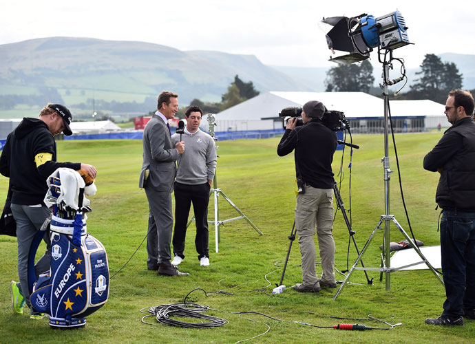 Rory McIlroy took time from his practice session for a television interview.