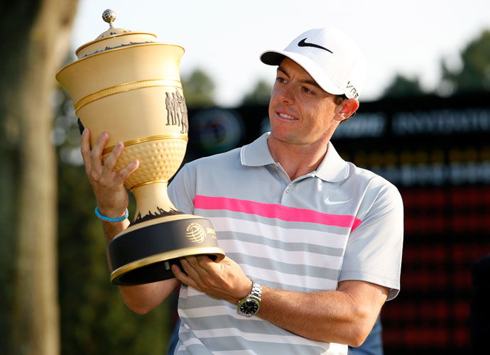 McIlroy admires his new hardware. The title -- his eighth on the PGA Tour -- comes on the heels of his wire-to-wire victory at the British Open.