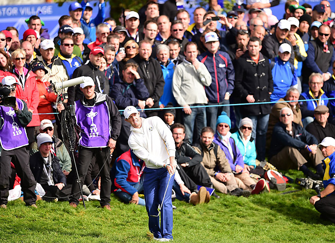 Rory McIlroy teamed with Sergio Garcia to win his first match of the tournament.