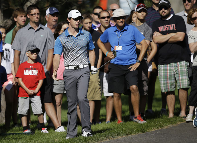 "Rory McIlroy hits out of the rough on the 13th hole. McIlroy shot 78 after opening with a 63 in the first round. ""I didn't realize how thick the rough was until I got in it today,"" McIlroy said."
