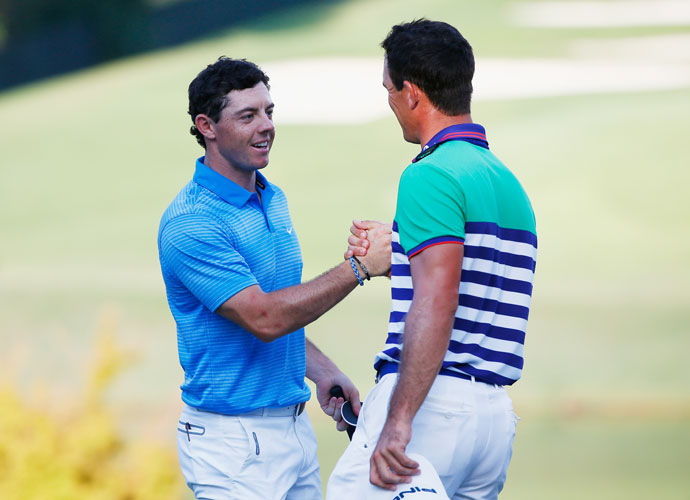 Rory McIlroy and Billy Horschel shake hands on the 18th green following the third round of the Tour Championship at East Lake on Saturday. McIlroy's 3-under 67 drew him even with Horschel for the 54-hole lead at 9 under.