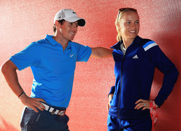 Rory McIlroy began 2014 by announcing his engagement to tennis star Caroline Wozniacki, who joined him after his second-place finish at the Abu Dhabi HSBC Golf Championship in January (left). The two broke off their engagement later that year.