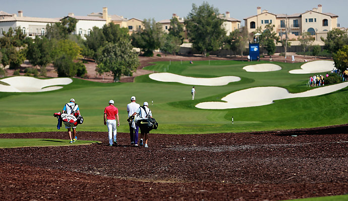 McIlroy walks with playing partner Henrik Stenson on the 7th hole at Jumeirah Golf Estates' Earth Course.