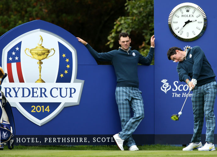 Martin Kaymer watches Rory McIlroy rip a drive off the 15th tee during their practice round.