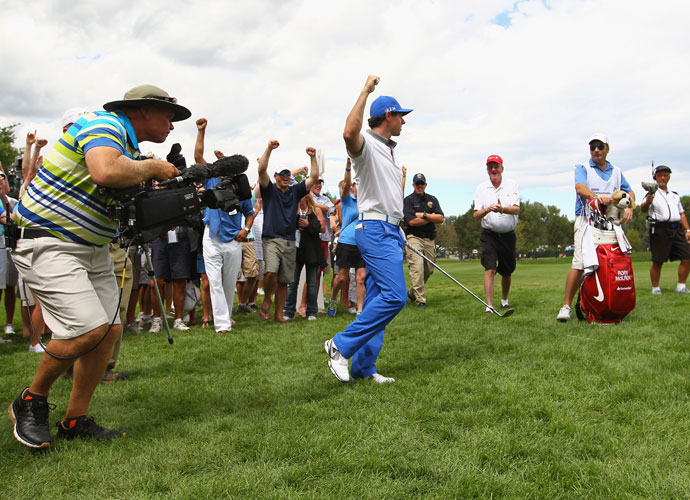 Rory McIlroy celebrates holing out for eagle from the rough on the 7th hole. He finished T8 after a 4-under 66.