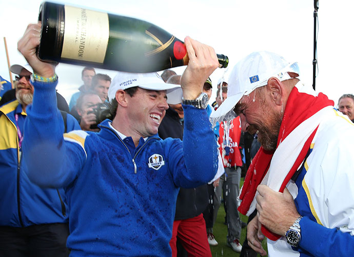 Rory McIlroy douses Thomas Bjorn with champagne on the last hole at Gleneagles.