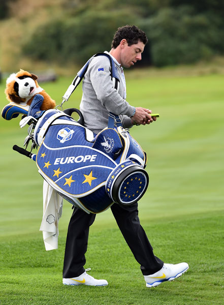 Rory McIlroy carried his European team bag after a session on the driving range at Gleneagles.