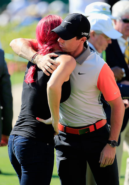 Rory McIlroy gets a post-round hug from fiancé Caroline Wozniacki. McIlroy shot a 1-under 71.