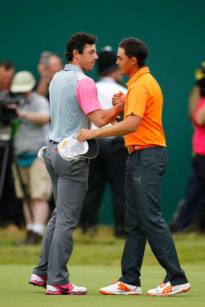 Rickie Fowler congratulates Rory McIlroy on the 18th green. Fowler shot 67 Sunday and was tied for second, two shots back. He was the only player to shoot in the 60s every round this week at Hoylake.