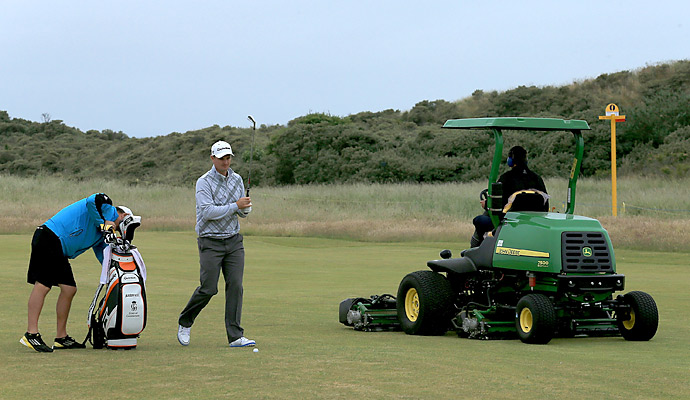 Members of the grounds crew were hard at work preparing Muirfield for the Open while Rose practiced.
