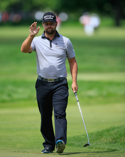 Ryan Moore acknowledges the crowd after making eagle on the sixth hole.