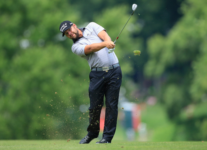 Ryan Moore shot a bogey-free 4-under 66 to take a one-shot lead at the Travelers Championship at TPC River Highlands on Saturday.