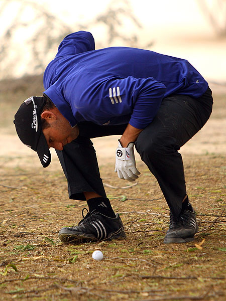 Sergio Garcia had to be very careful not to incur a penalty as he inspected the lie of his ball on the 14th hole. The young Spaniard shot 71 to finish in a tie for fifth.