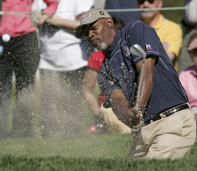Actor Samuel L. Jackson hits out of a bunker on the second hole during the 2006 3M Celebrity Golf Challenge February 8, 2006 at Pebble Beach. At the event, celebrities played 5 holes of golf with proceeds going to charity.