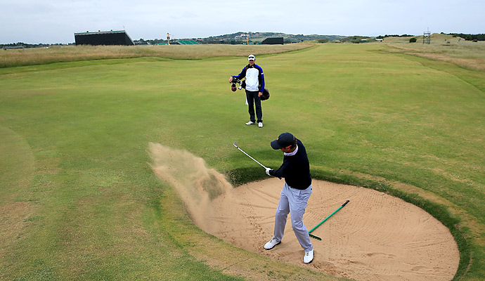 Scott practiced hitting left-handed out of a tough lie in one of the course's numerous pot bunkers.