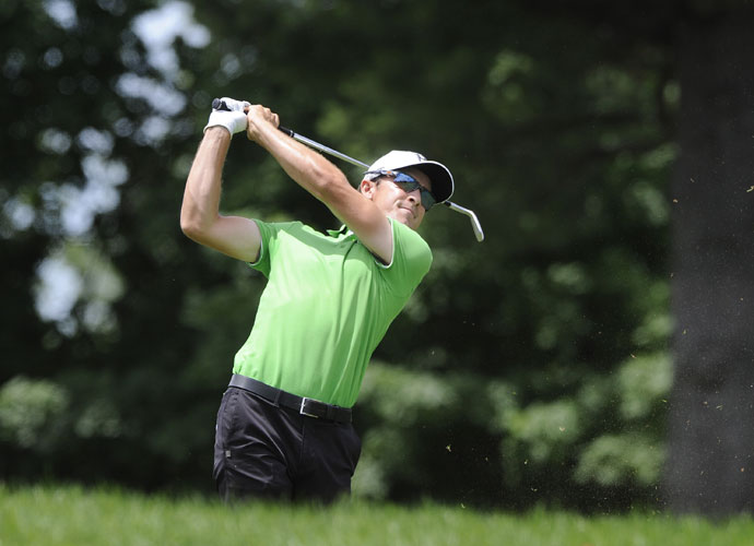 Scott Langley watches his approach shot on the ninth hole during the second round of the Travelers Championship. Langley shot 65 and was -11, a shot ahead of three players tied for second.