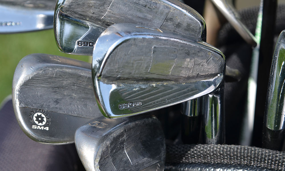 Scott Piercy's Titleist 690 irons are almost unrecognizable under their coating of weighted tape.