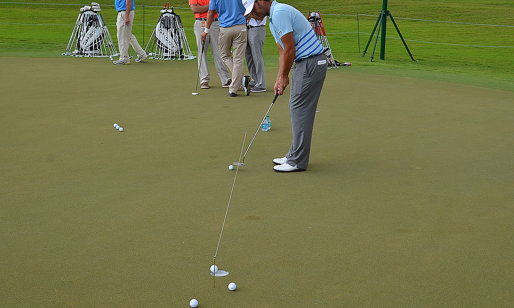 Scott Piercy honed his putting stroke on the practice green Tuesday with the help of a string and two knitting needles.