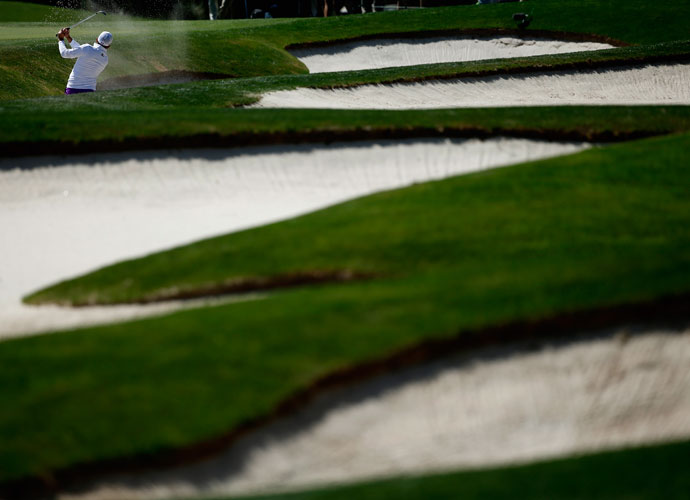 Sergio Garcia blasts out of a bunker on the fourth hole. He birdied the hole, one of his five birdies in the round.