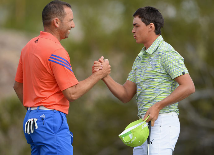 Sergio Garcia congratulates Rickie Fowler after Fowler posted a 1-up victory.