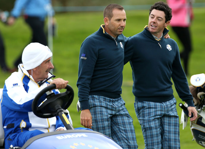 Sergio Garcia and Rory McIlroy walk alongside team vice captain Sam Torrance during their practice round Tuesday.