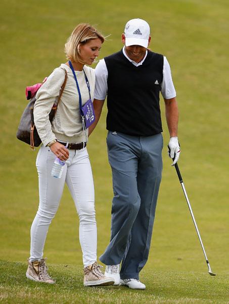 Sergio Garcia walks with girlfriend Katharina Boehm during his Wednesday practice round.