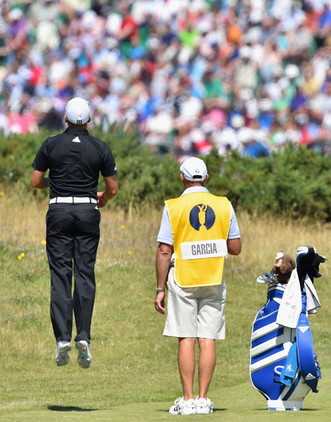 Sergio Garcia checks his line during the first round. He was among the early starters and shot 68, two shots off the lead.