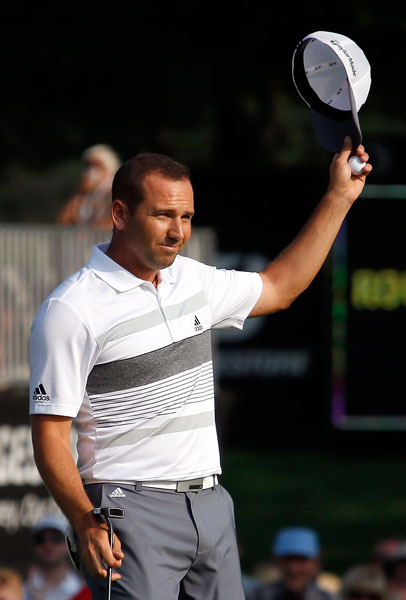 Sergio Garcia stormed to a three-shot lead with a course-record tying 61 in the second round at Firestone Country Club.