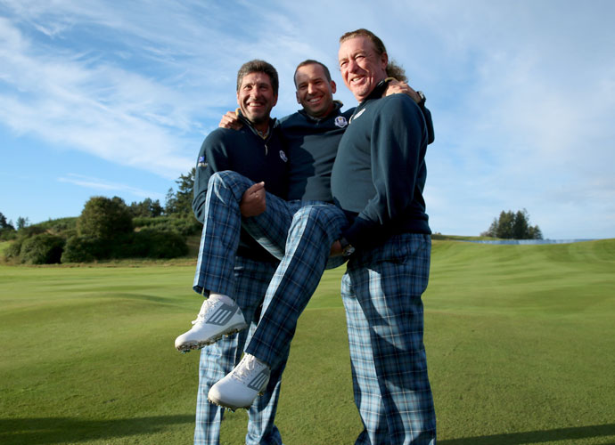 Sergio Garcia gets a lift from European vice captains Jose Maria Olazabal and Miguel Angel Jimenez.