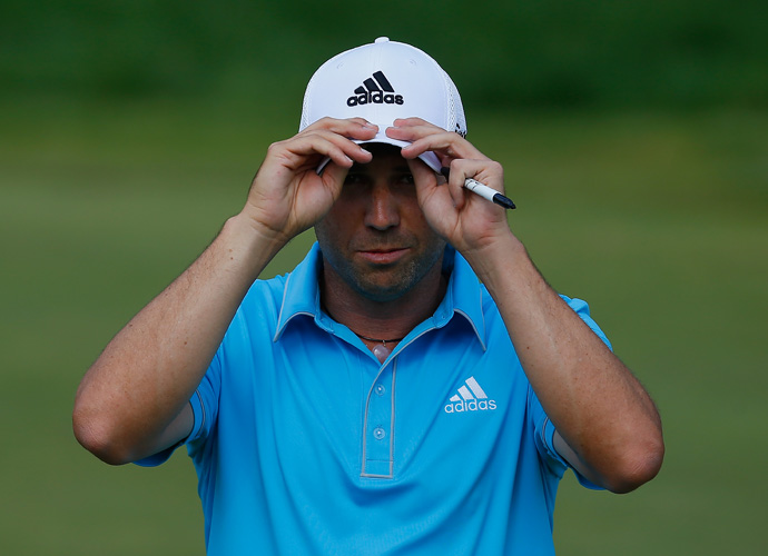 Sergio Garcia of Spain matched Baddeley's 65 to move into a tie for third at 11-under.