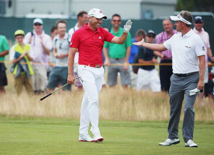 Sergio Garcia celebrates with Luke Donald after Garcia holed his second shot for an eagle on the second hole.