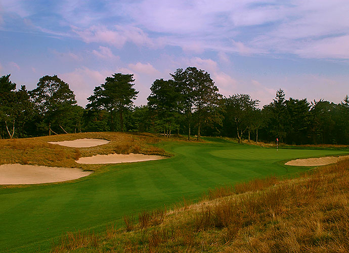 13. Shinnecock Hills Golf Club, Southampton, N.Y., No. 14, par-4: Hitting the valley fairway that turns gently to the right is the key to solving Shinny's 14th, a task complicated by deep bunkers, ever-present wind and a hillside to the right. Few holes in golf fit the land so perfectly hand-in-glove as this stern, 449-yarder.