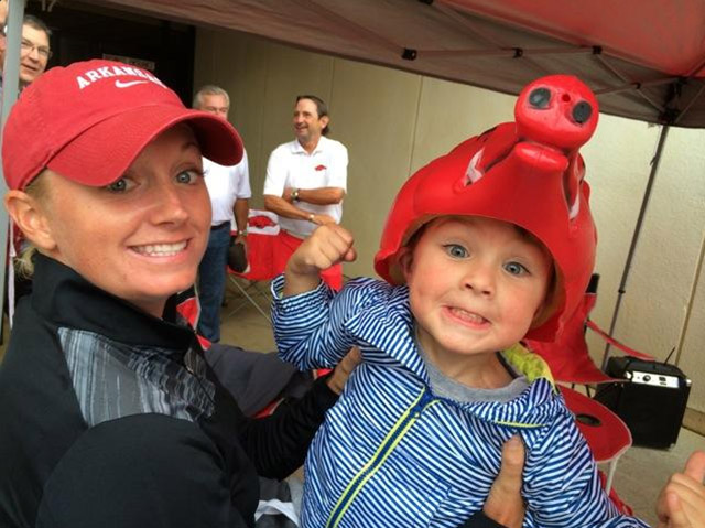 "Razorback alumna Stacy Lewis hung out with her youngest fan. Stacy: ""And my favorite picture from the game! I think I'm turning him into a Razorback ;)"""