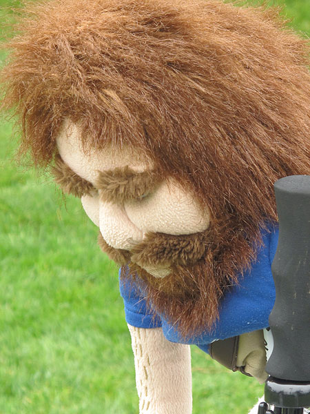 Cavemen used to carry clubs, but this one covers Steve Marino's Cleveland driver.