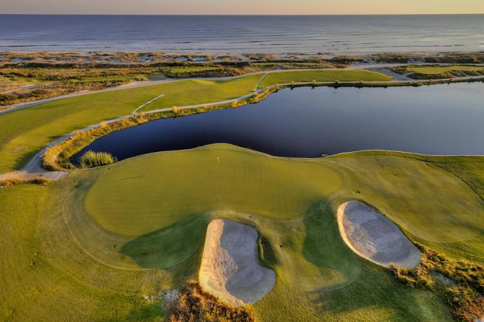 Kiawah Island Ocean Club                           Hole 17, 223 yards, Par 3 The tee shot at this par-3 is one of the scariest on the course. Players must carry a pond to get to this diagonal green. Those who play it safe must hope to avoid the pair of deep pot bunkers that guard the green's left side.