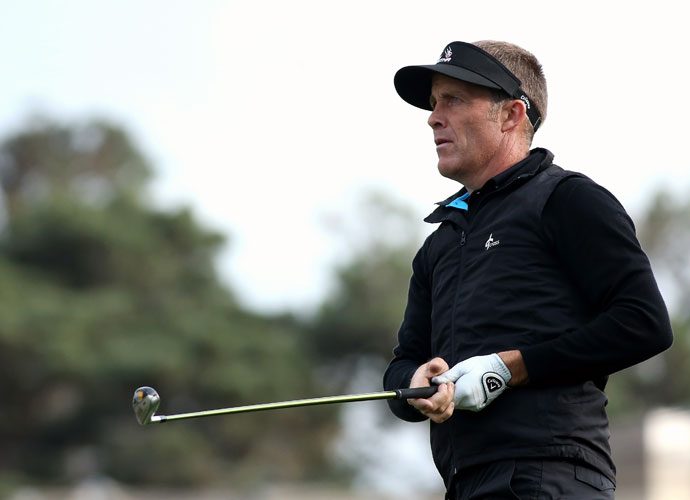 Stuart Appleby watches the flight of his tee shot on the seventh hole at Monterey Peninsula Country Club. Appleby shot a six-under 65, two shots behind leader Andrew Loupe.