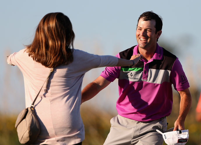 Streb celebrates his playoff victory with his wife Maggie.