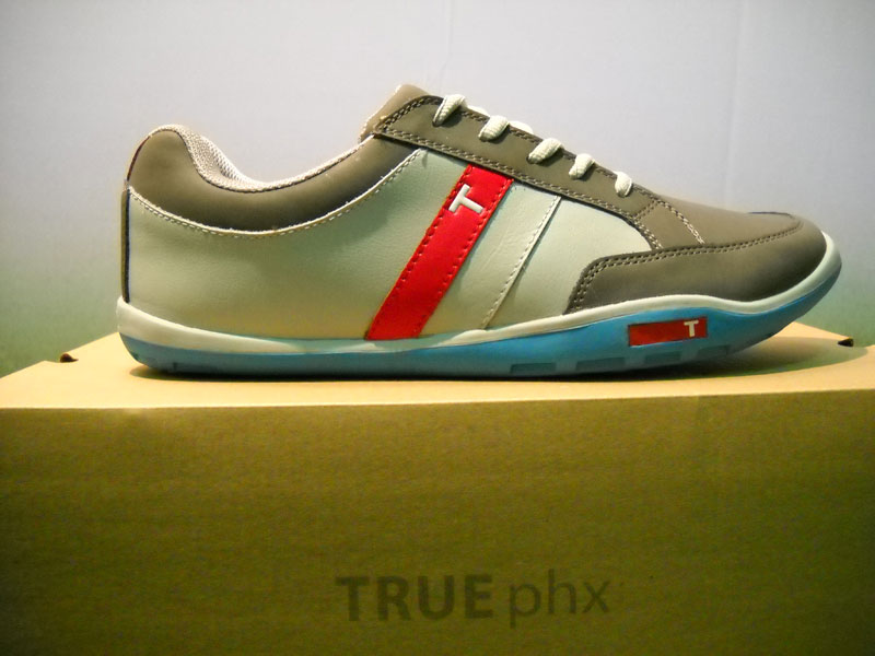 "TRUE Linkswear                           Just another quirky athletic shoe? Hardly. The new TRUE Linkswear golf shoe, the Phoenix PHX, incorporates the ""barefoot"" design concept (with a 2.5 mm sole) and a roomy toe box. Like a slipper with traction. The reshaped design has a recessed spike bed for the course, but also makes a stylish street shoe. Wear on rainy days. ($99)"